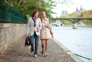 Romantic couple walking on the Seine rive banks