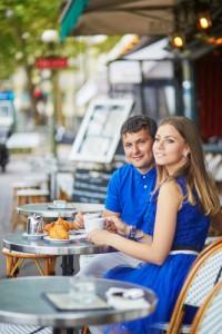 beautiful young couple enjoying a dinner in Paris